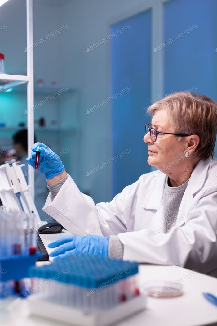 Professional chemist taking a sample for medical expertise