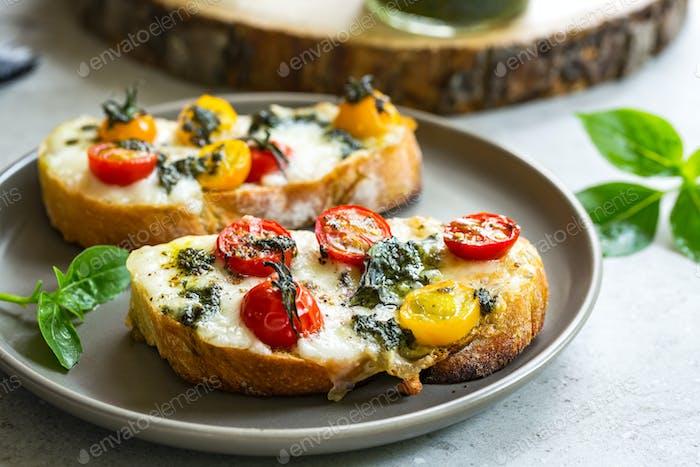 Melt Mozzarella with Cherry Tomatoes and Pesto on toast