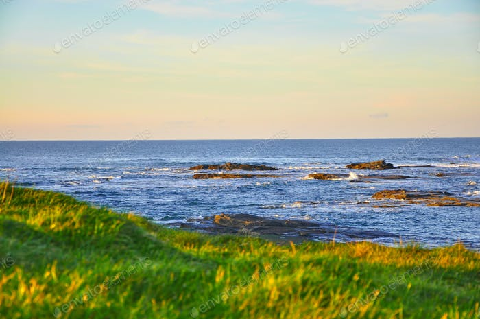 Sunny Cliffs of Kilkee in Ireland county Clare Sunset. Tourist destination