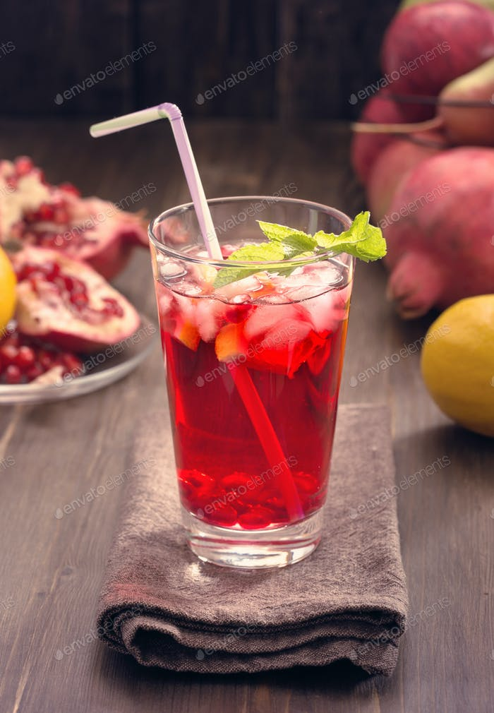 Pomegranate with lemon and ice toned