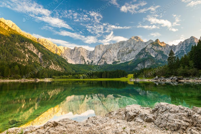 Beautiful Day at Fusine Lake in Italy. Forest and Mountains Refl