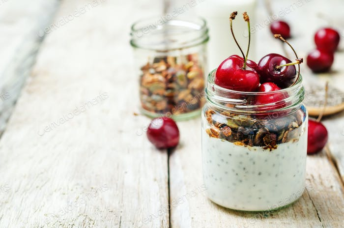 Chia seeds granola Greek yoghurt pudding with cherries
