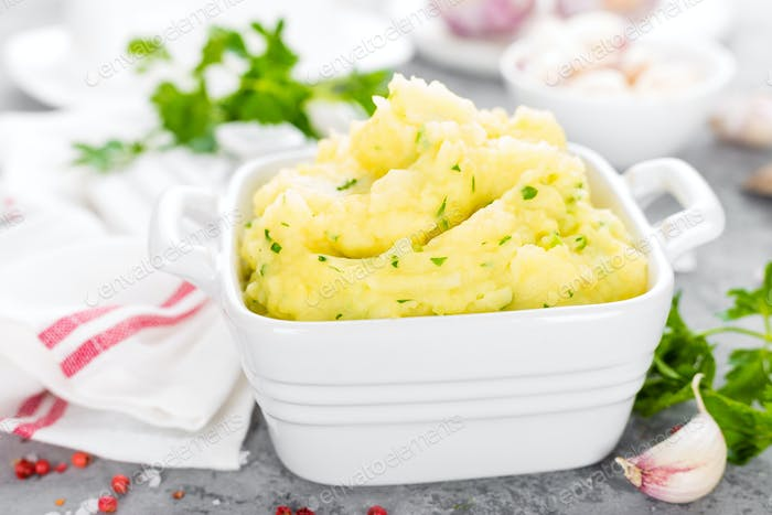 Mashed potato. Potato mash with garlic and parsley. Boiled potato. Potato puree