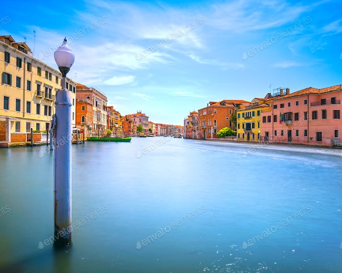 Pole and soft water on Venice lagoon in Grand Canal. Long exposu