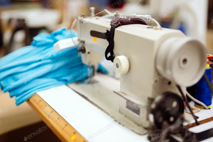 Sewing machine with textile on desk