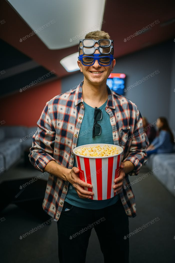 Male spectator in 3d glasses, cinema hall