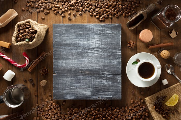 cup of coffee and ingredients on wood