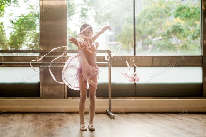 A little girl practising ballet