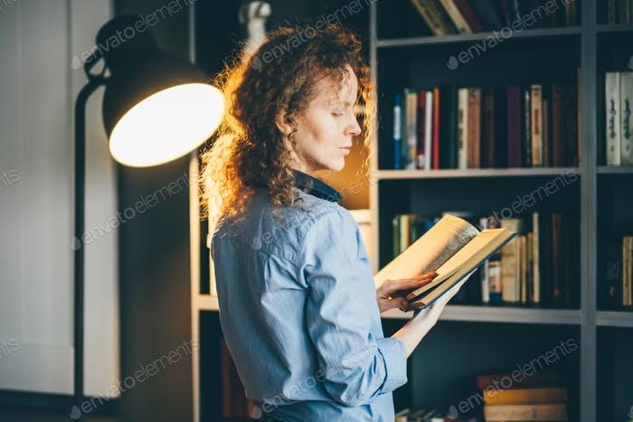 Portrait of beautiful blond woman with notebook