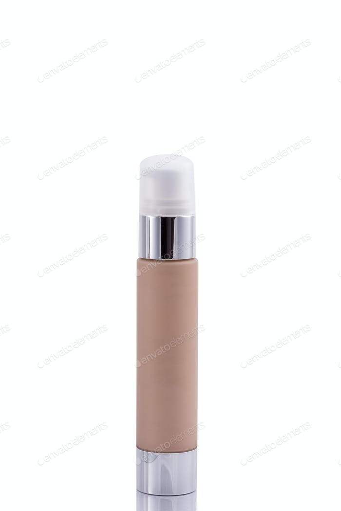 Cosmetic bottle with dark brown liquid inside isolated over whit