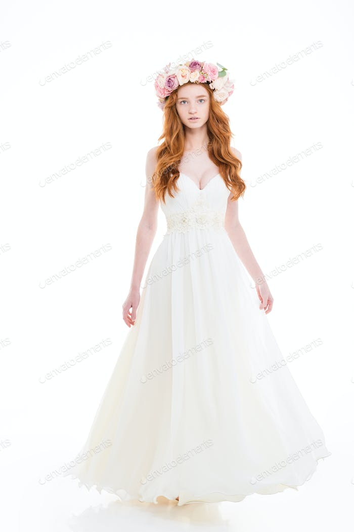 Beautiful sensual young woman in wedding dress and flower wreath