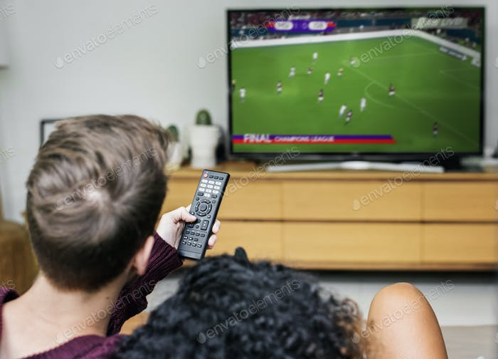 Couple watching a football game on TV