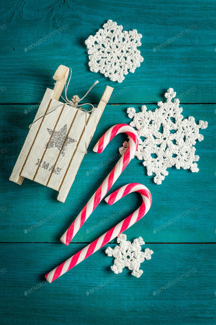 Christmas candy canes, toy sledge and snowflakes