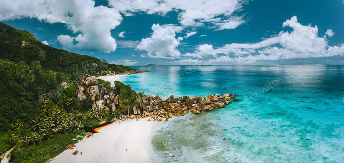 Aerial panoramic view of beautiful Grand Anse beach on La Digue island in Seychelles