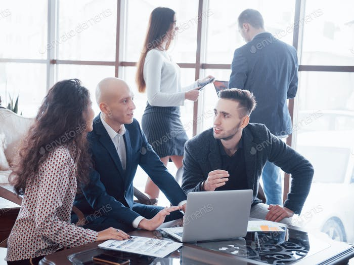Young team of coworkers making great business discussion in modern coworking office