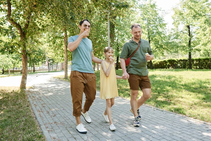 Gay couple walking with child
