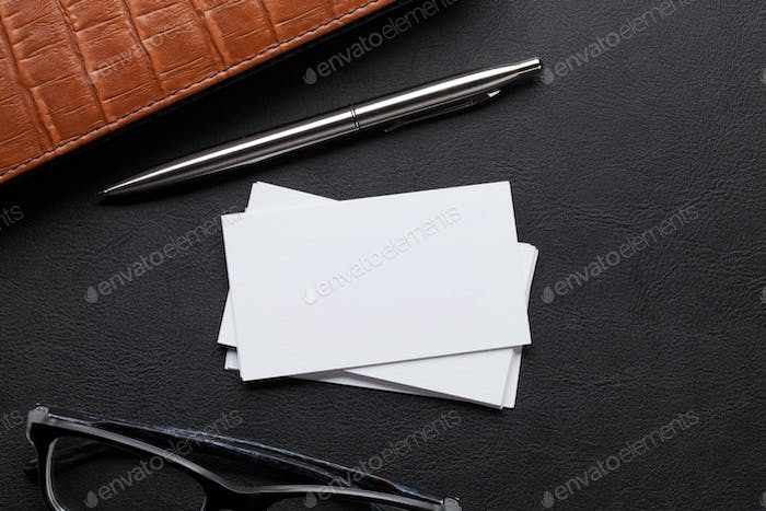 Office desk with business cards and supplies