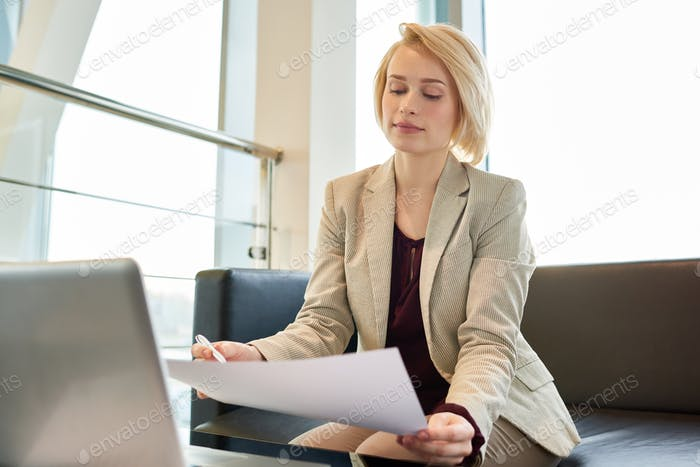Blond-haired Entrepreneur Focused on Work
