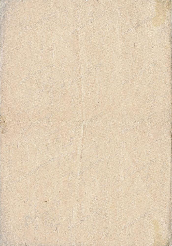 Vintage yellowish paper, vertical orient.
