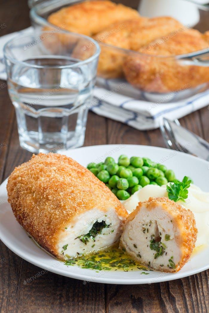 Chicken Kiev, ukrainian cuisine. Cutted chicken cutlet in bread