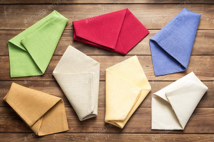 cloth napkin on at rustic wooden background, top view