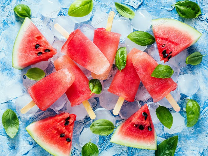 Top view of watermelon and basil popsicles