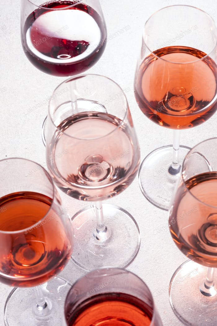 Degustation different varieties, colors and shades of pink wine concept