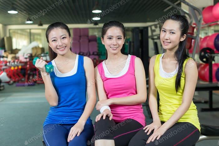 Young Asian women having rest after exercise in the gym