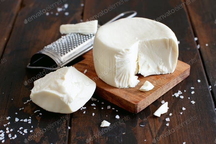 South Italian cheese cacioricotta with a grater