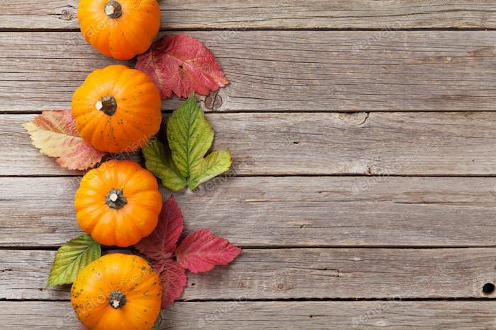 Autumn pumpkins frame on wooden table