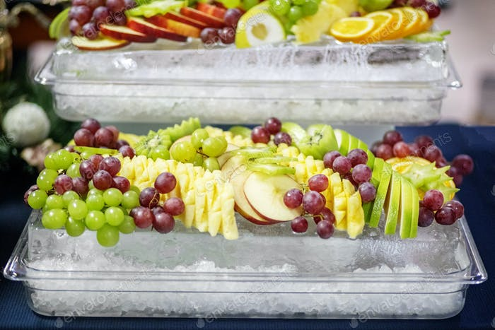 An assortment of fruit apples, grapes, pineapples and citrus on