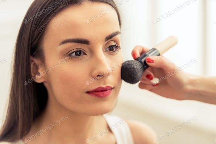 Beautiful girl doing makeup