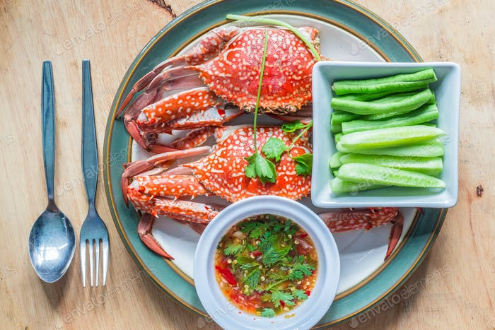 Steamed crabs on a wooden table