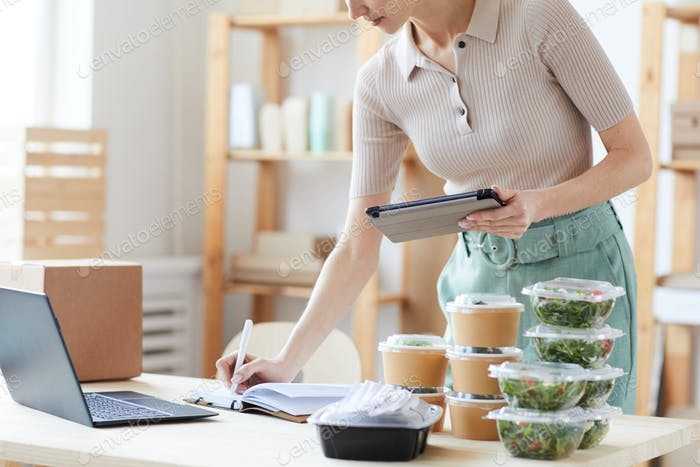 Woman working in food delivery service