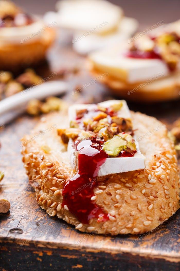 Bruschetta with brie cheese and raspberry jam.