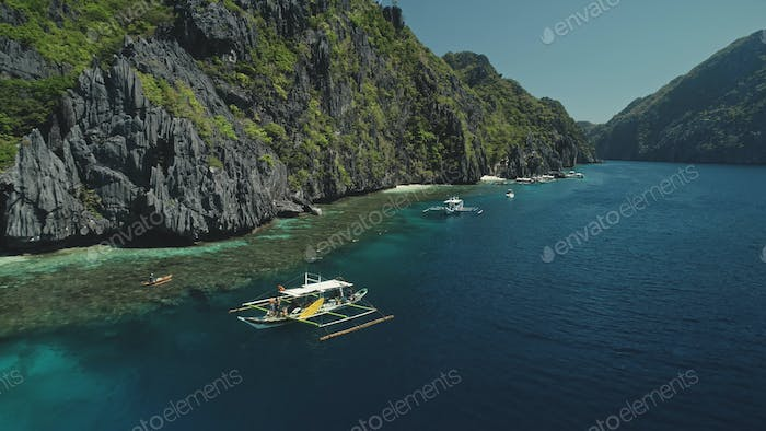 Closeup vessels at sea bay with passengers at summer paradise cruise. Amazing exotic seascape