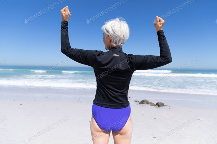 Senior Caucasian woman standing at the beach.