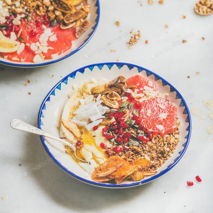 Healthy breakfast yogurt bowls with seeds, fruit, nuts, granola