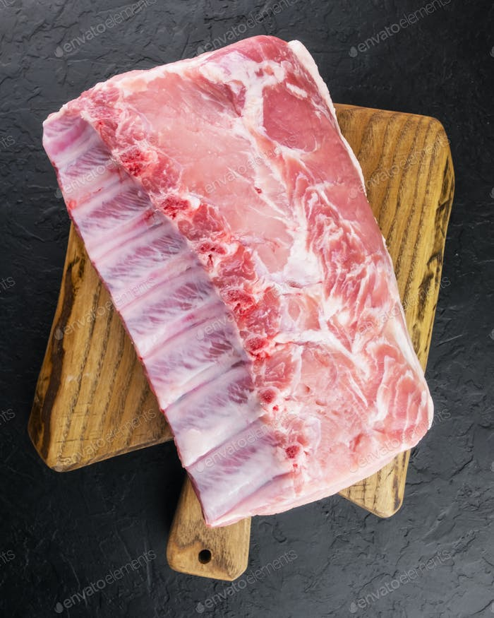 Fresh raw pork piece on wooden board