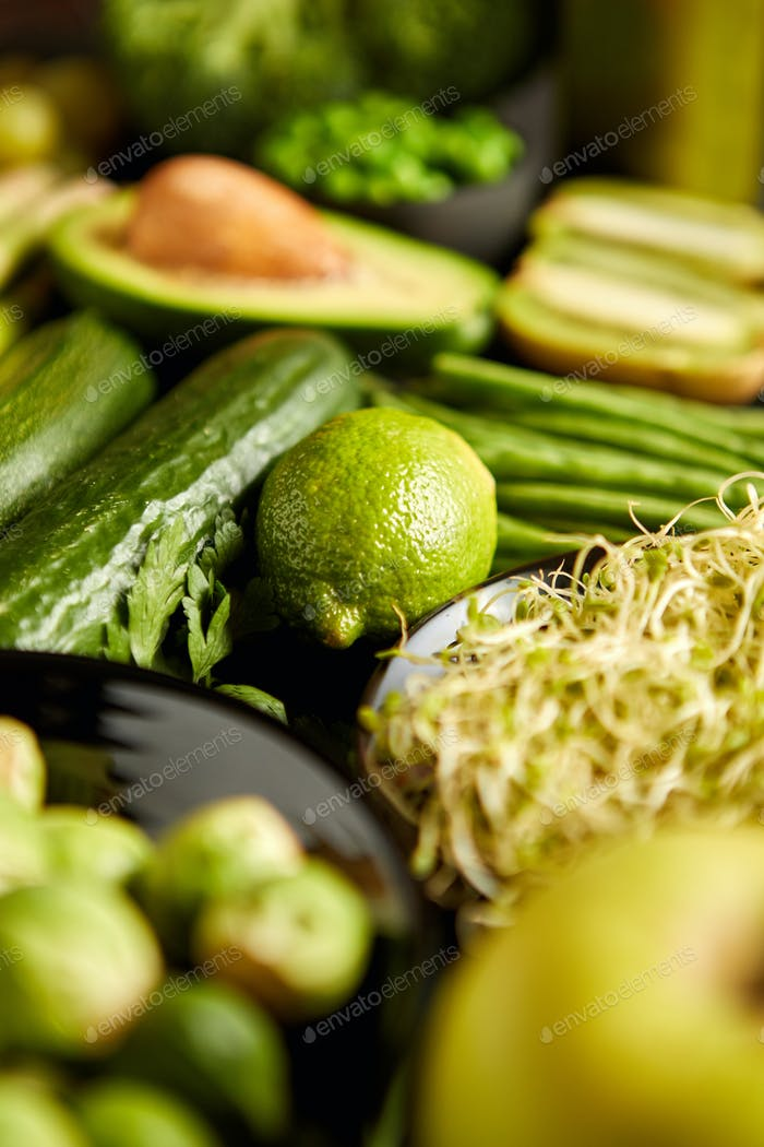 Green healthy food composition with avocado, broccoli, apple, smoothie