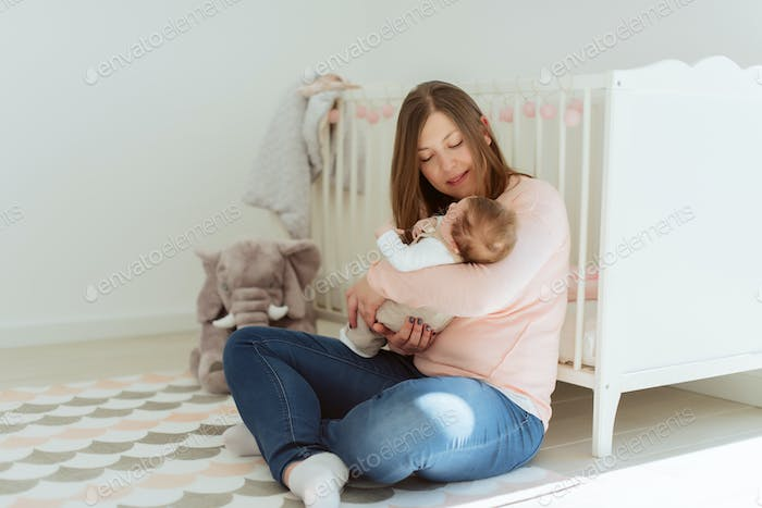 Young Mother holding newborn baby