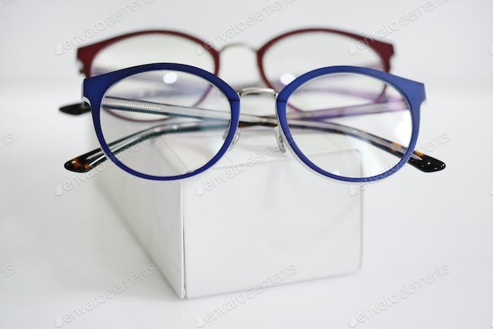 Multicolored fashionable glasses on a white case
