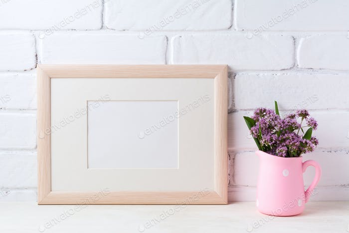 Wooden landscape frame mockup with purple flowers in pink rustic