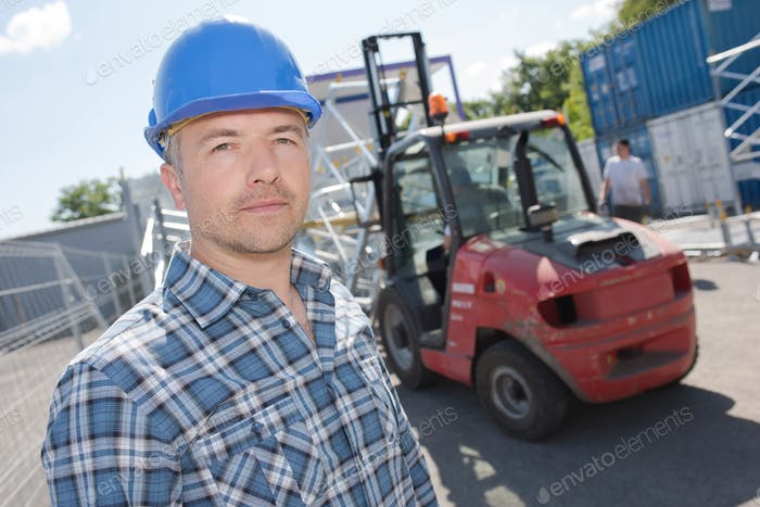 Portrait of man in front of forklift