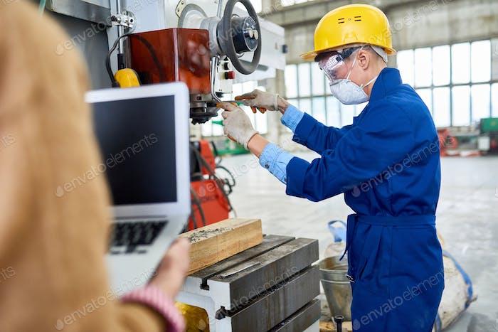Busy specialist repairing machine