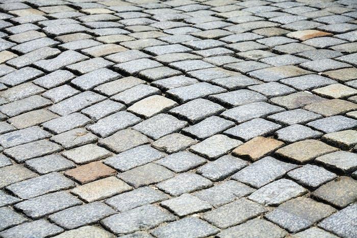 Cobblestone street pavement, urban background