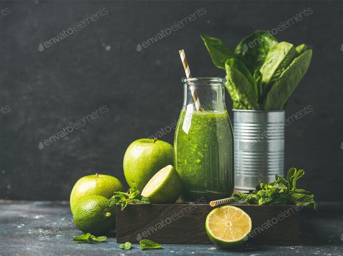 Green smoothie in bottle with fresh fruits, copy space