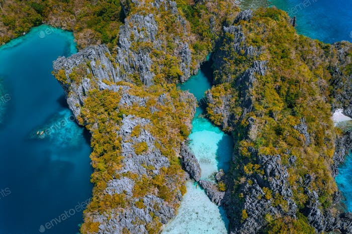 Aerial drone top down view of turquoise big and small lagoon and lime stone cliffs. Marine National