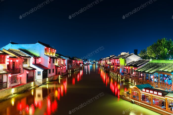chinese ancient town with grand canal at night