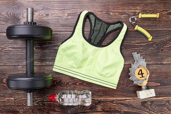 Sport equipment, prize, wooden background